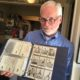 Doug McWilliams displays Oakland Oaks baseball cards photo